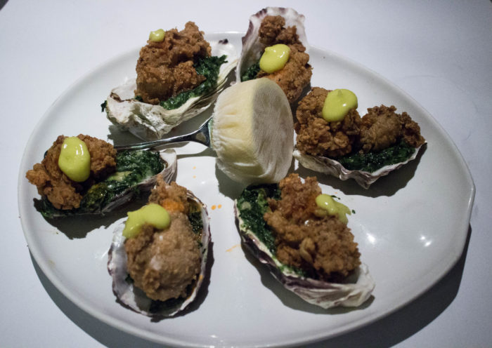 East hampton grill OYSTERS ST. CHARLES - fried oysters served on the half shell with creamed spinach and lemon aioli ($22)